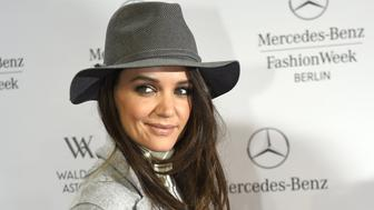 US Actress Katie Holmes poses upon arrival at the show of fashion house Marc Cain at the Mercedes-Benz Fashion Week in Berlin on January 20, 2015.  AFP PHOTO / TOBIAS SCHWARZ        (Photo credit should read TOBIAS SCHWARZ/AFP/Getty Images)