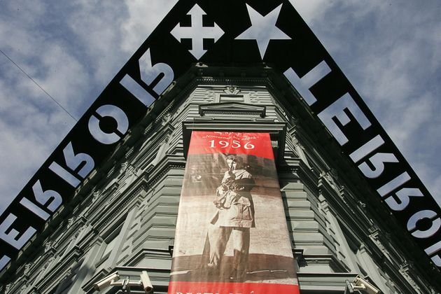 Budapest, HUNGARY:  A picture taken 02 November 2006 shows a poster of 'House of Terror' exhibition about the 1956 Hungarian uprising hanguing on the building of a museum in downtown Budapest. The museum, which was the former headquarters of Hungarian Nazi party 'Nyilas' and later the state security police (AVH) is dedicated to the 3.600 victims who were killed in the vaults of the building during the II World War and after the 1956 revolution. Hungary commemorates for the 50 anniversary of the freedom fighting against communist regim and Soviet Red Army in 04 November 2006 when the Soviet tanks were begun their offensive against Budapest.  AFP PHOTO / ATTILA KISBENEDEK  (Photo credit should read ATTILA KISBENEDEK/AFP/Getty Images)
