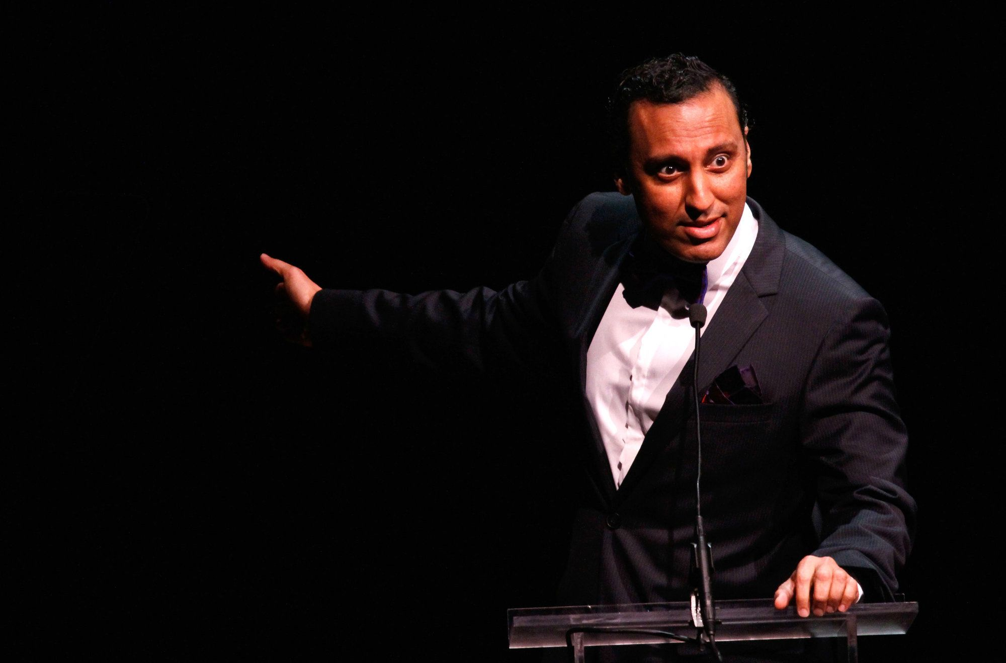 NEW YORK, NY - MAY 05:  Host Aasif Mandvi speaks onstage at the 28th Annual Lucille Lortel Awards on May 5, 2013 in New York City.  (Photo by Janette Pellegrini/Getty Images for Lucille Lortel Awards)