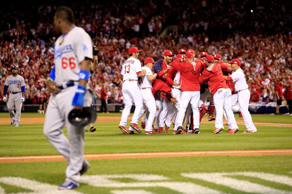 ST LOUIS, MO - OCTOBER 07:  The St. Louis Cardinals celebrate after defeating the Los Angeles Dodgers as Yasiel Puig #66 of t