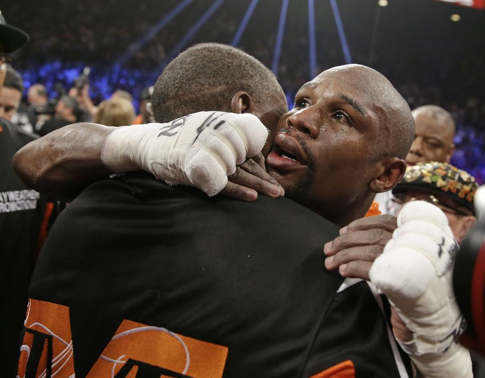 Floyd Mayweather Jr., right, is embraced by his father, head trainer Floyd Mayweather Sr., at the finish of his welterweight