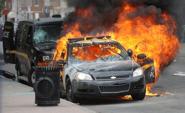 A Maryland Transit Authority patrol car burns at North and Pennsylvania Avenues on Monday, April 27, 2015, Baltimore, MD, USA