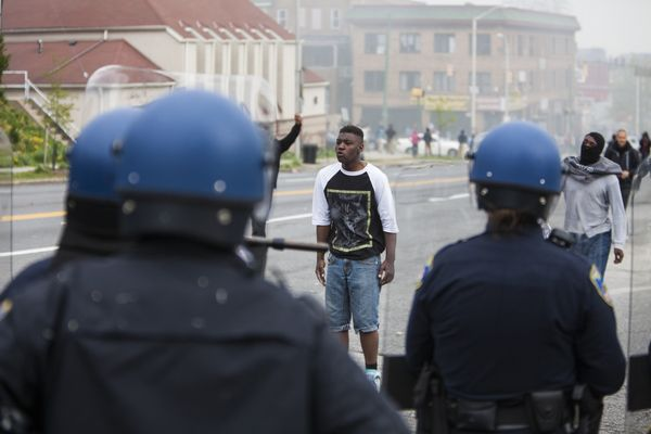 WASHINGTON, USA - APRIL 27: A protestor taunts police during riots in Baltimore, USA on April 27, 2015. Protests following th