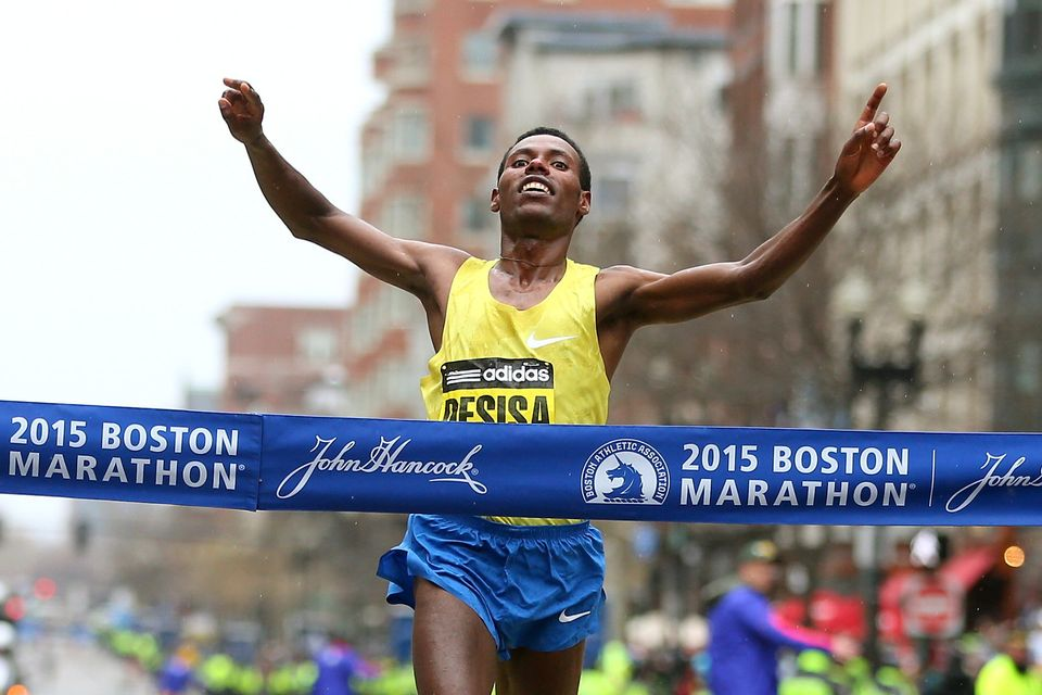 BOSTON, MA - APRIL 20:  Lelisa Desisa of Ethiopa crosses the finish line to win the 119th Boston Marathon on April 20, 2015 i