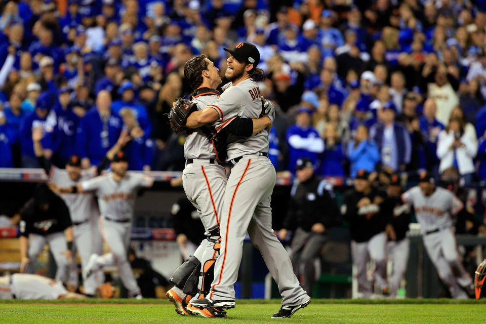 KANSAS CITY, MO - OCTOBER 29:  Buster Posey #28 and Madison Bumgarner #40 of the San Francisco Giants celebrate after defeati