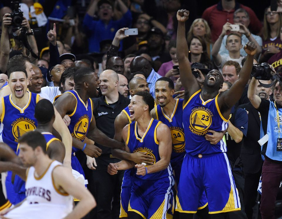 The Golden State Warriors celebrate after defeating the Cleveland Cavaliers in Game 6 to win the 2015 NBA Finals on June 16,