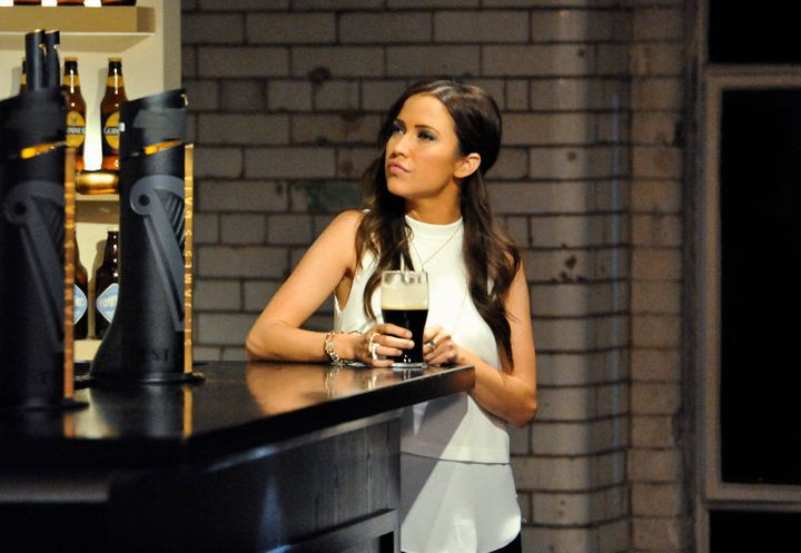 Kaitlyn stares off into the distance, wistfully.