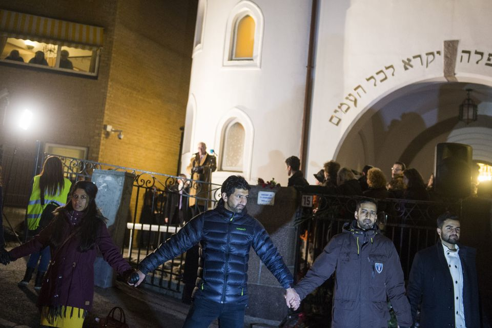 Norwegian Muslims create a human peace ring around the synagogue in Oslo, Norway on February 21, 2015.