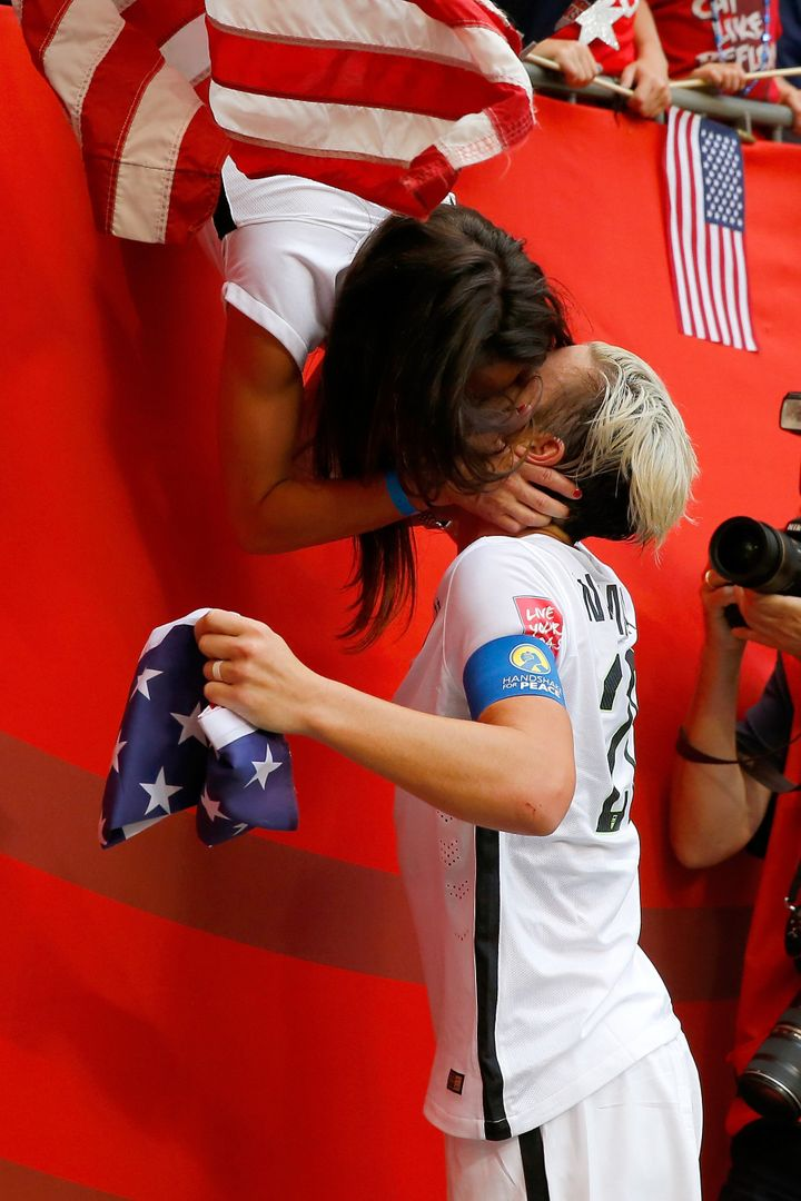 U.S. soccer player Abby Wambach celebrates with wife Sarah Huffman after the U.S. team's 5-2 victory against Japan in the FIF