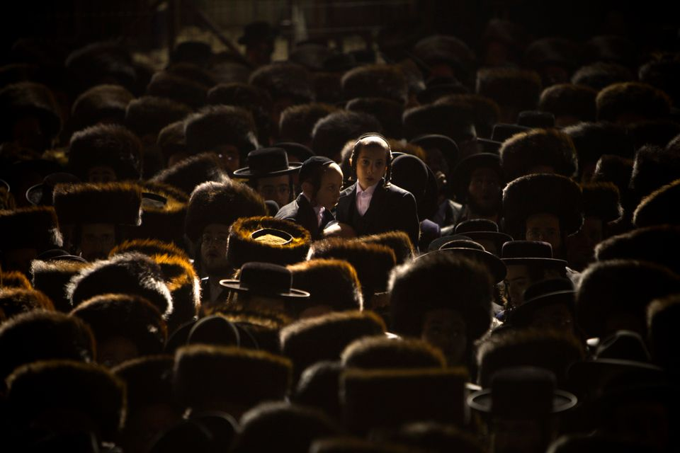 In this Wednesday, Jan. 23, 2013 photo, Ultra-Orthodox Jews gather for traditional Jewish wedding of the granddaughter of Sat