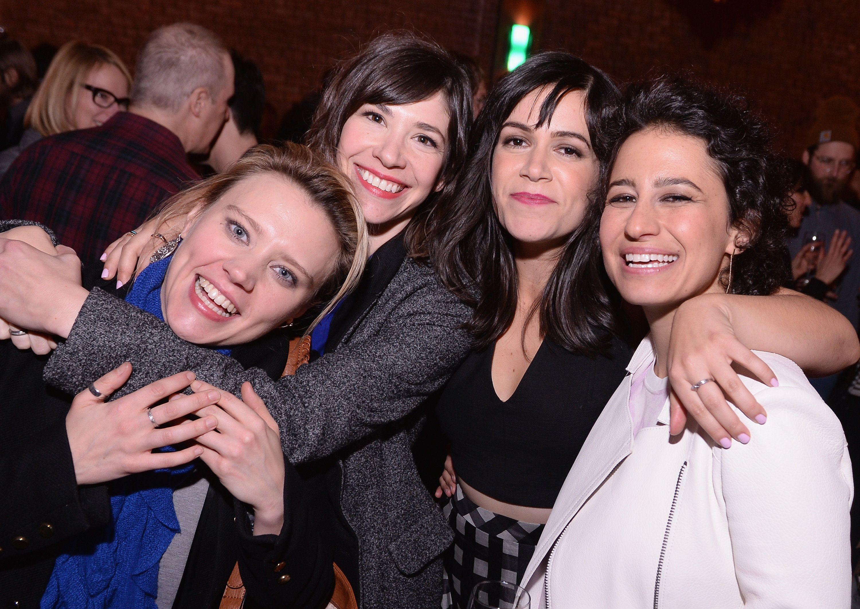 NEW YORK, NY - JANUARY 07:  (L-R)  Actress Kate McKinnon, actresss/musician Carrie Brownstein, actress/writer Abbi Jacobson, and actress/writer Ilana Glazer attend The Broad City Season 2 Premiere Party at 26 Bridge Street on January 7, 2015 in New York City.  (Photo by Stephen Lovekin/Getty Images for Comedy Central)