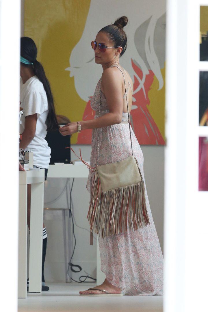 <em>Jennifer Lopez goes shopping in the Hamptons wearing a flowy summer dress.</em>