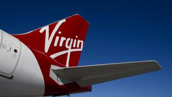 The tail of a Virgin America Inc. Airbus A320 plane is seen on the tarmac at San Francisco International Airport (SFO) in San Francisco, California, U.S., on Thursday, Nov. 6, 2014. Virgin America Inc., the seven-year-old airline partially owned by U.K. billionaire Richard Branson, is seeking as much as $320 million in an initial public offering in the U.S. Photographer: David Paul Morris/Bloomberg via Getty Images