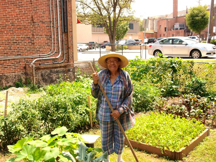 A Pleasant Hope church member tends tothe church garden.