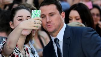 LONDON, ENGLAND - JUNE 30:  Actor Channing Tatum poses with a fan as he attends the European Premiere of 'Magic Mike XXL' at Vue West End on June 30, 2015 in London, England.  (Photo by Tim P. Whitby/Getty Images)