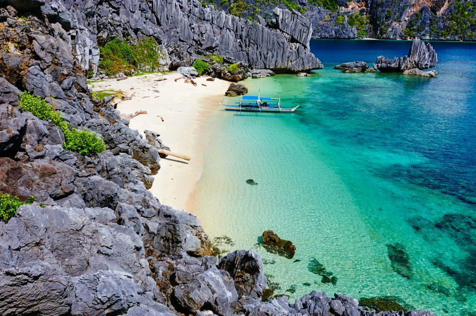 """Named <a href=""""http://www.huffingtonpost.com/2014/11/24/coron-palawan-philippines_n_6193058.html"""">one of the best islands in"""