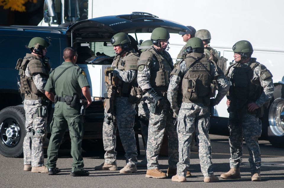 Swat team members secure the scene near Sparks Middle School in Sparks, Nev., after a shooting there on Monday, Oct. 21, 2013