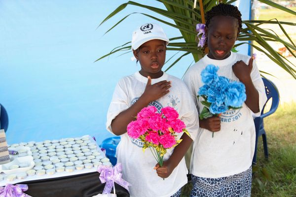 Liberian children offer prayers with flowers in memory of all Liberians who have died of the Ebola virus