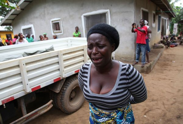 Liberian woman weeps over the death of a relative from Ebola in the Banjor Community on the outskirts of Monrovia, Liberia 0
