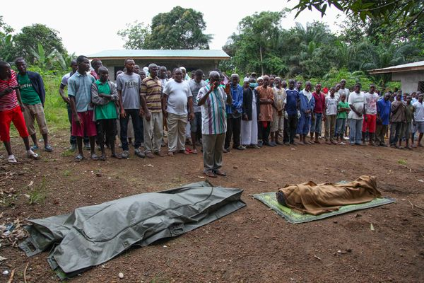 Liberian Muslims perform prayers before the burial of Ebola victims in the Banjor Community on the outskirts of Monrovia, Lib