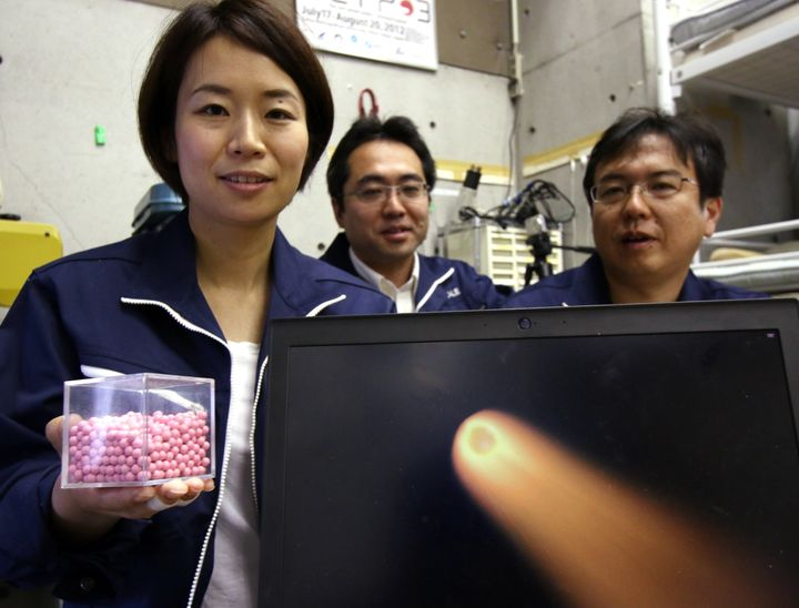 Lena Okajima of space startup ALE shows the pellets she says can be used to create artificial m