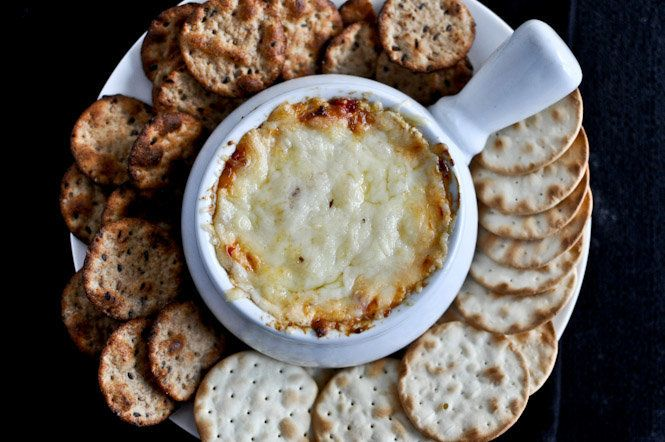 "<strong>Get the <a href=""http://www.howsweeteats.com/2011/12/hot-cheesy-roasted-red-pepper-dip/"" target=""_blank"">Cheesy Roast"