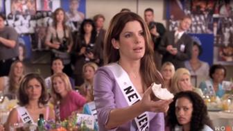 """Sandra Bullock in the movie """"Miss Congeniality"""" apologizing for eating a bite of her bagel before praying."""