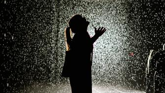 A visitor at the 'Rain Room'  at MOMA ( The Museum of Modern Art ) May 20, 2013. MoMA PS1 is presenting as part of a major component of EXPO 1: New York, a exhibit entitled Rain Room (2012), which will be presented at The Museum of Modern Art, from May 12 through July 28, 2013. A large-scale environment by Random International, Rain Room is a  field of falling water that pauses wherever a human body is detected—offering visitors the experience of controlling the rain.  'MANDATORY MENTION OF THE ARTIST UPON PUBLICATION' AFP PHOTO / TIMOTHY CLARY        (Photo credit should read TIMOTHY CLARY/AFP/Getty Images)