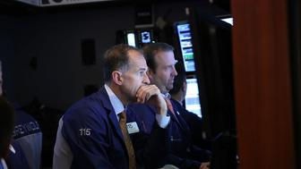 NEW YORK, NY - JULY 09:  Traders work on the floor of the New York Stock Exchange (NYSE) a day after the market closed for over three hours yesterday due to a 'technical glitch' on July 9, 2015 in New York City. The market had a normal opening today with no reports of problems.  (Photo by Spencer Platt/Getty Images)
