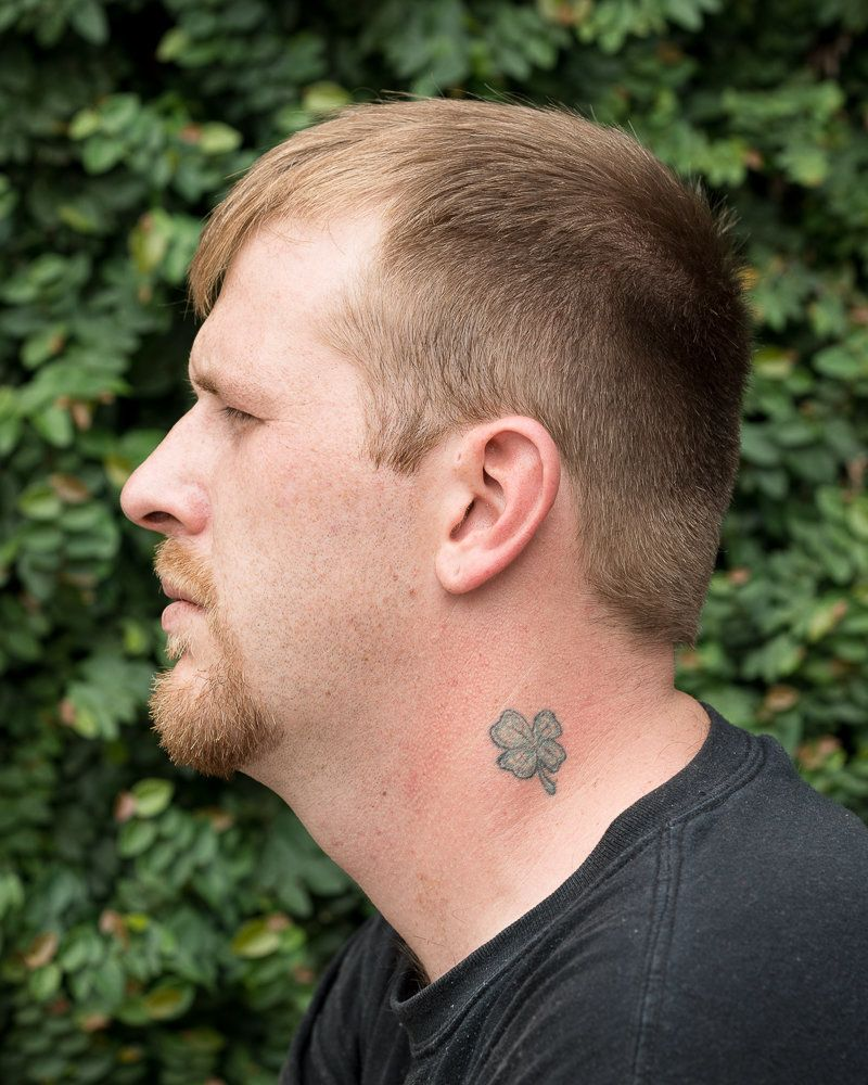 Chris and his mother have matching four-leaf clover tattoos on their necks as a symbol of their cultural heritage and as a wa