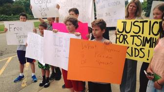 <p>Parents and children protest for the release of three Michigan children who were sent to a juvenile detention center for refusing to communicate with their father, Wednesday July 8, 2015. Oakland County Circuit Judge Lisa Gorcyca lifted the contempt of court charge and ordered they be released and sent to summer camp Friday. </p>