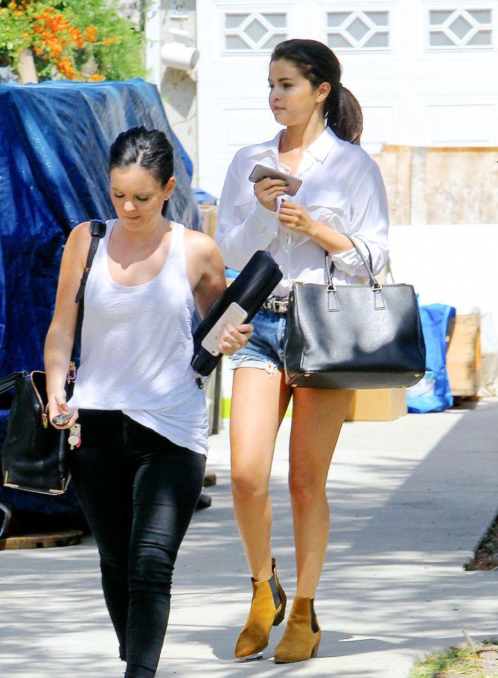 Selena Gomez keeps it casual in denim shorts.