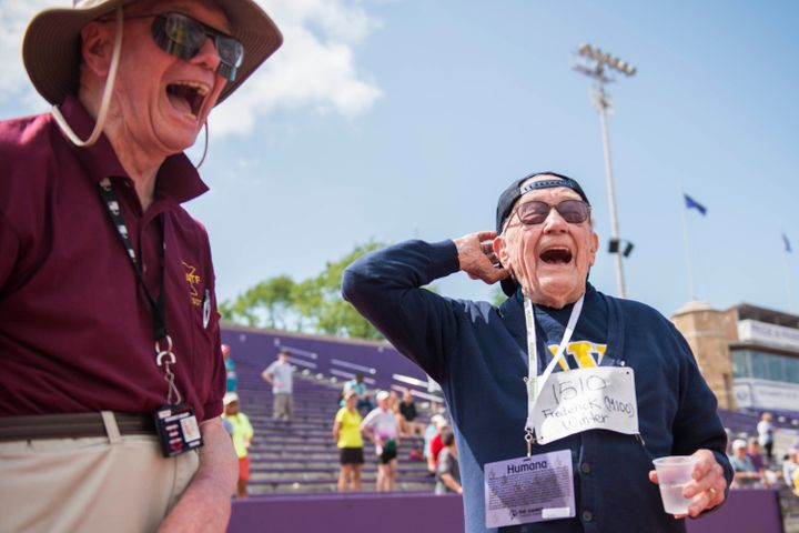 Frederick Winter celebrates completing the mens 100 meter race  at the the age 99 at the National Senior Games at the Univers