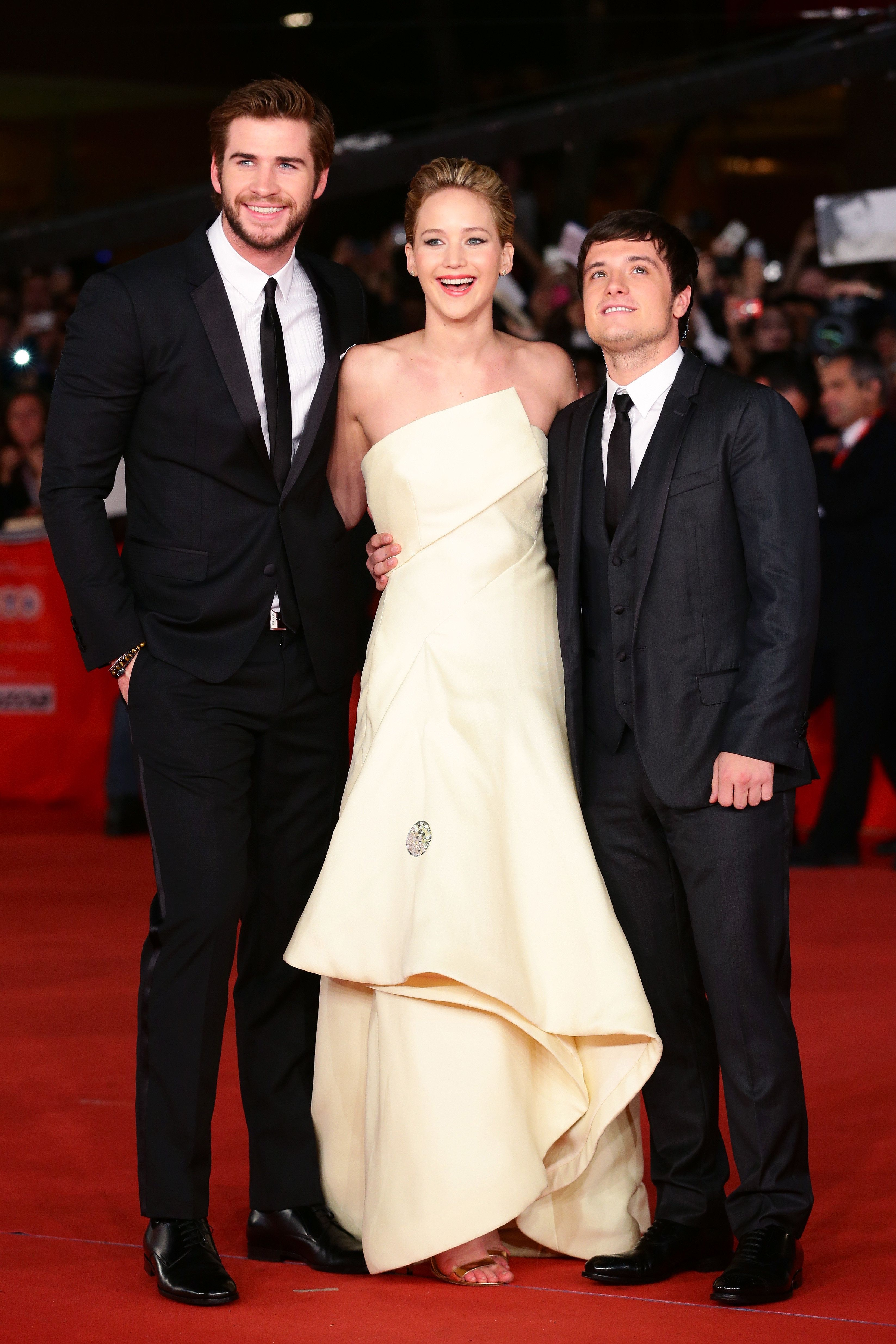 ROME, ITALY - NOVEMBER 14:  (L-R) Actors Liam Hemsworth, Jennifer Lawrence and Josh Hutcherson attend the 'The Hunger Games: Catching Fire' Premiere during The 8th Rome Film Festival at Auditorium Parco Della Musica on November 14, 2013 in Rome, Italy.  (Photo by Vittorio Zunino Celotto/Getty Images)