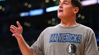 LOS ANGELES, CA - APRIL 12:    Dallas Mavericks owner Mark Cuban talks to a referee during a timeout in the game with the Los Angeles Lakers at Staples Center on April 12, 2015 in Los Angeles, California.  The Mavericks won 120-106. NOTE TO USER: User expressly acknowledges and agrees that, by downloading and or using this photograph, User is consenting to the terms and conditions of the Getty Images License Agreement.  (Photo by Stephen Dunn/Getty Images)