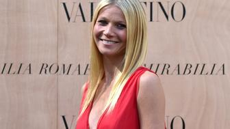 US actress Gwyneth Paltrow poses for a photocall as she arrives at the Valentino haute couture Fall-Winter fashion show on July 9, 2015 in Rome, as part of the celebration of the opening of a new flagship Valentino store in Rome. AFP PHOTO / ALBERTO PIZZOLI - FRANCE OUT -        (Photo credit should read ALBERTO PIZZOLI/AFP/Getty Images)