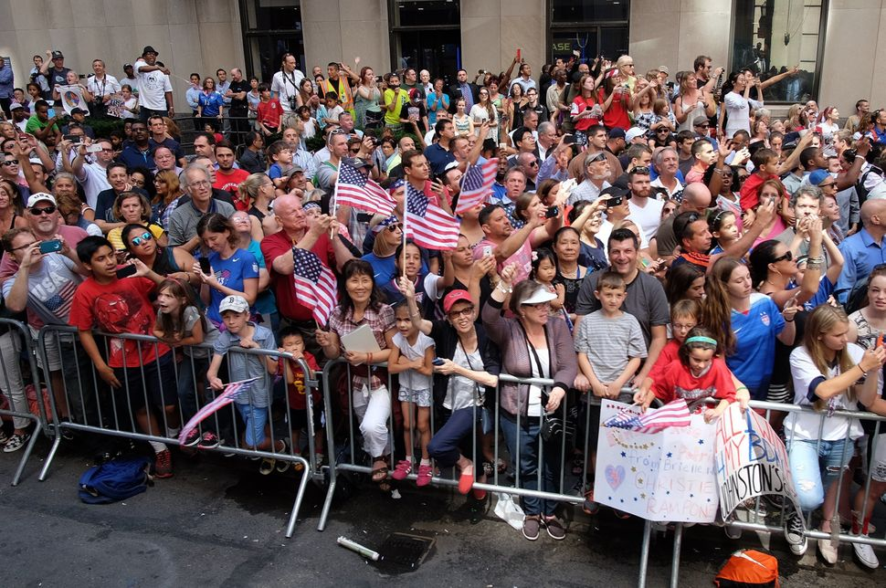 USA women's soccer team fans cheer during the ticker-tape parade in New York on July 10, 2015, to celebrate the team World Cu