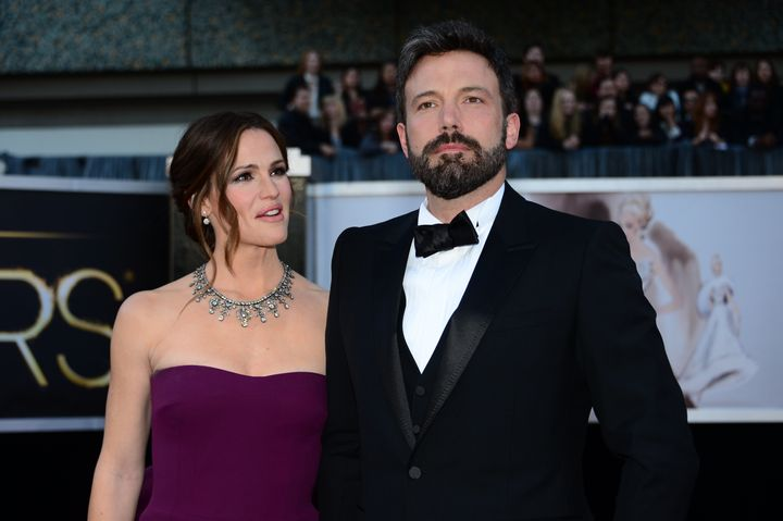 Actor/director Ben Affleck and wife actress Jennifer Garner arrive on the red carpet for the 85th Annual Academy Awards on Fe