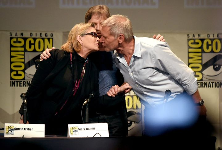 SAN DIEGO, CA - JULY 10:  (L-R) Actors Carrie Fisher, Mark Hamill and Harrison Ford pose onstage at the Lucasfilm panel durin