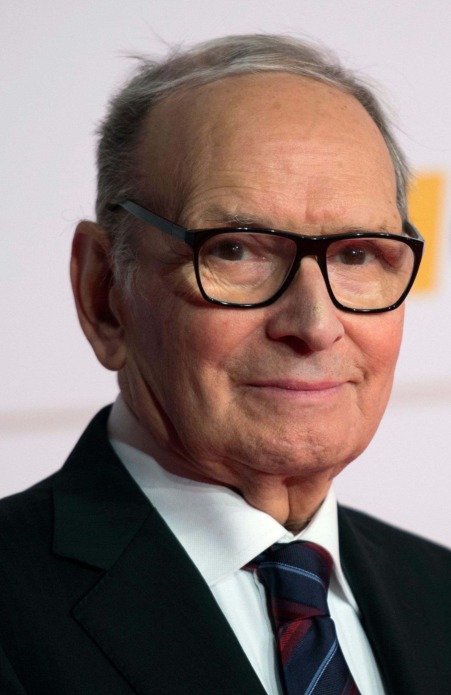 Italian film composer Ennio Morricone poses for photographers as he arrives at the 26th European Film Awards ceremony on December 7, 2013 in Berlin. Every year, the various activities of the European Film Academy culminate in the ceremony of the European Film Awards. In a total of 21 categories, among them European Film, European Director, European Actress and European Actor, the European Film Awards annually honour the greatest achievements in European cinema. AFP PHOTO / JOHANNES EISELE        (Photo credit should read JOHANNES EISELE/AFP/Getty Images)
