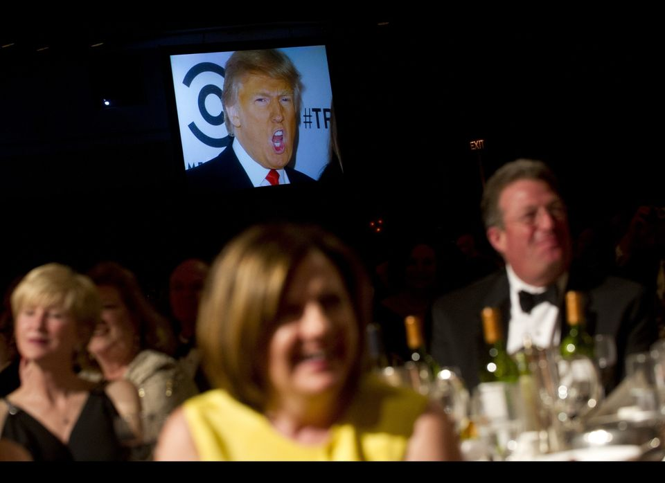 A picture of Donald Trump appears on a screen as US President Barack Obama tells a joke during the White House Correspondents