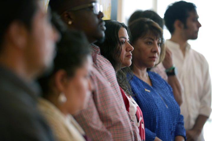 WASHINGTON, DC - MAY 18:  Marcia Cruz (C), who was originally from El Salvador, stands with other immigrant workers during a