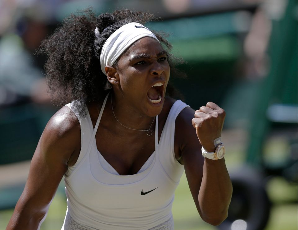 Serena Williams of the United States celebrates winning a point against Garbine Muguruza of Spain  during the women's singles