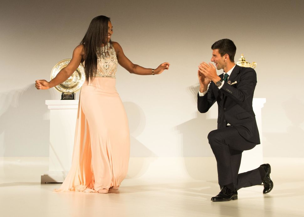 LONDON, ENGLAND - JULY 12:  (EDITORIAL USE ONLY - NO COMMERCIAL USEAGE)  Serena Williams of the United States and Novak Djoko