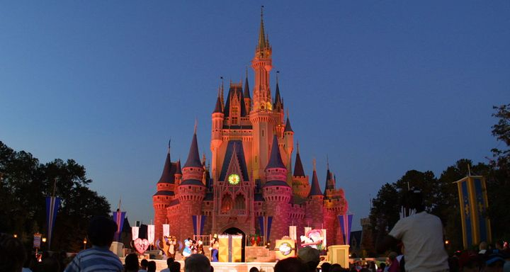 ORLANDO, FL - NOVEMBER 11: (FILE PHOTO) People watch a show on stage in front of Cinderella's castle at Walt Disney World's Magic Kingdom November 11, 2001 in Orlando, Florida. Health officials said a salmonella outbreak at Walt Disney World sickened as many as 141 people, including visitors attending an athletic competition for organ-transplant recipients August 23. (Photo by Joe Raedle/Getty Images)