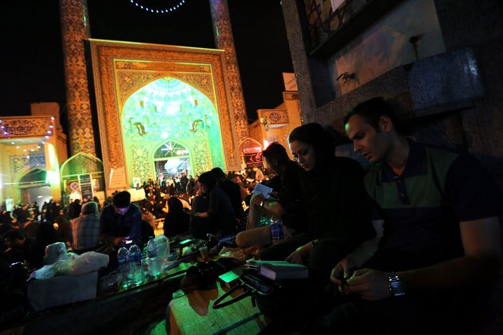Iranian Shiite Muslims pray in Tehran in the early hours of July 7, 2015 in commemoration of the death of the seventh century