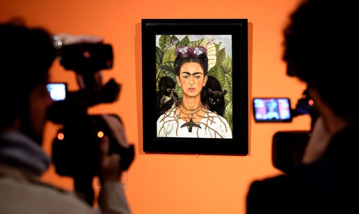Cameramen film the 'Self-portrait with with Thorn Necklace and Hummingbird' by Mexican artist Frida Kahlo during an exhibitio