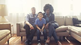 Happy family in living room together