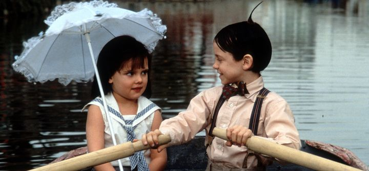 Bug Hall rowing a boat while looking at Brittany Ashton Holmes in a scene from the film 'The Little Rascals', 1994. (Photo by