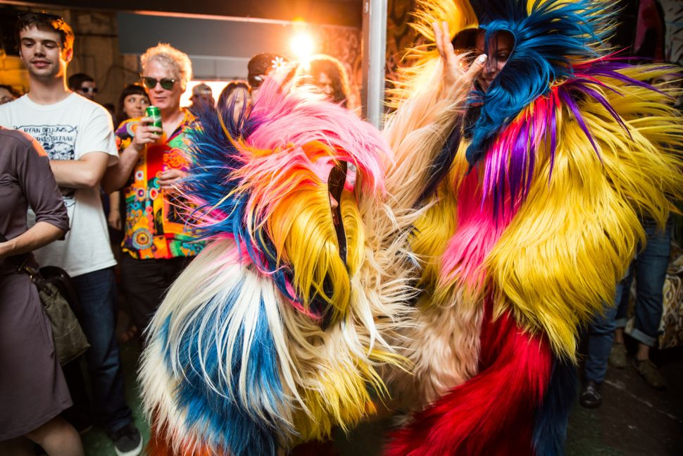Dancers from Sidewalk Detroit perform in Nick Cave's Soundsuits at The Artist Village.